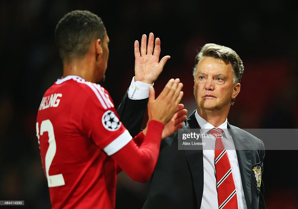 Louis van Gaal, manager of Manchester United celebrates victory with <a gi-track='captionPersonalityLinkClicked' href=/galleries/search?phrase=Chris+Smalling&family=editorial&specificpeople=5964313 ng-click='$event.stopPropagation()'>Chris Smalling</a> after the UEFA Champions League Qualifying Round Play Off First Leg match between Manchester United and Club Brugge at Old Trafford on August 18, 2015 in Manchester, England.