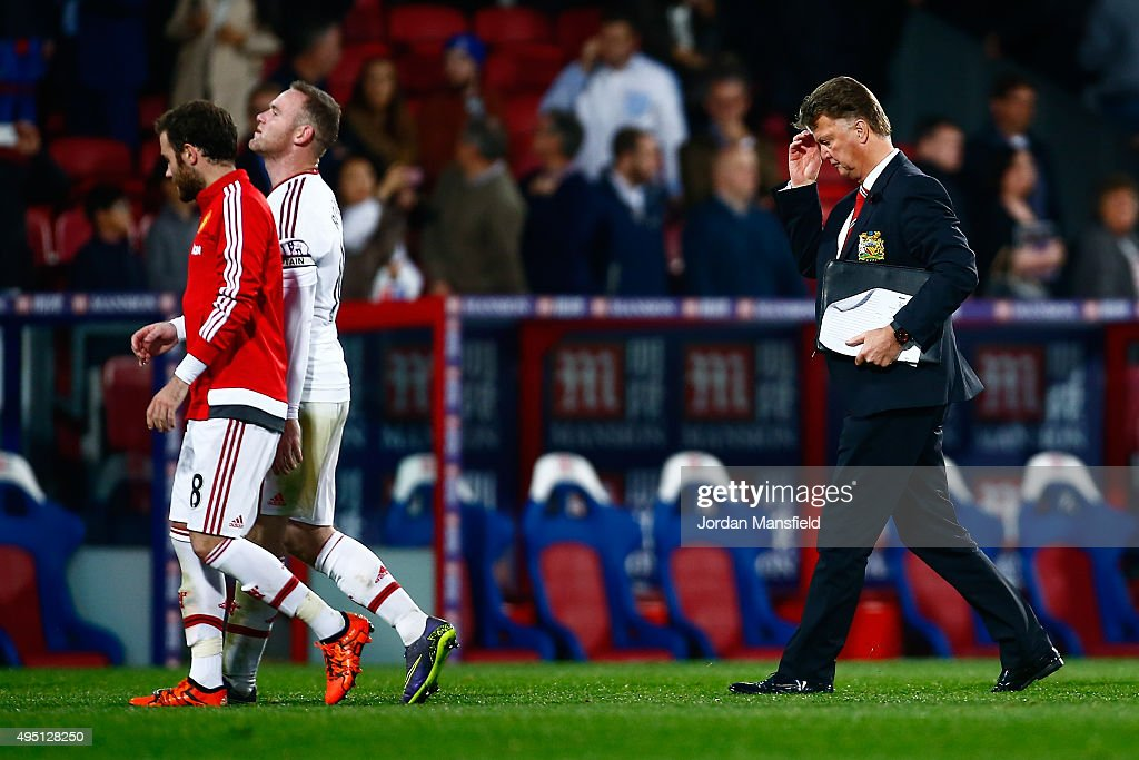 Louis van Gaal Manager of Manchester United (R) looks dejected as he walks off the pitch with Wayne Rooney and Juan Mata of Manchester United (L) after their 0-0 draw in the Barclays Premier League match between Crystal Palace and Manchester United at Selhurst Park on October 31, 2015 in London, England.