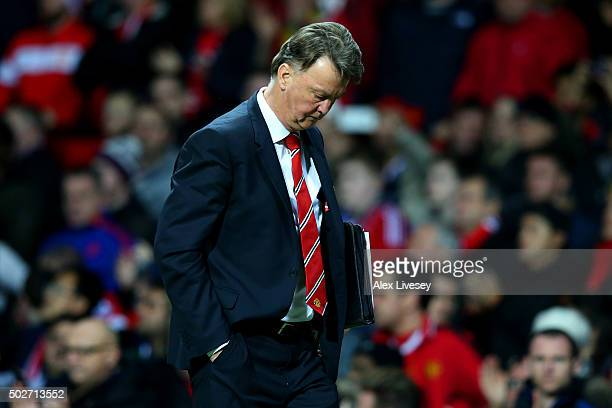 Louis van Gaal manager of Manchester United looks on as he walks back to the changing room at half time during the Barclays Premier League match...