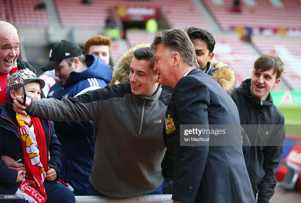 Louis van Gaal Manager of Manchester United poses for photographs with a supporter on arrival at the stadium prior to the Barclays Premier League match between Sunderland and Manchester United at the Stadium of Light on February 13, 2016 in Sunderland, England.