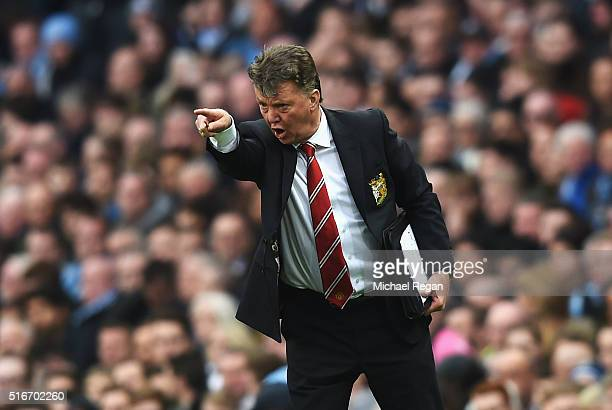 Louis van Gaal manager of Manchester United reacts during the Barclays Premier League match between Manchester City and Manchester United at Etihad...