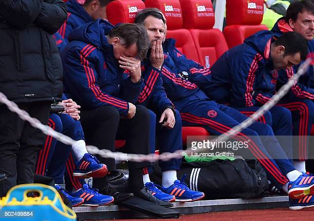 Louis van Gaal manager of Manchester United reacts on the bench next to his assistant Ryan Giggs during the Barclays Premier League match between...