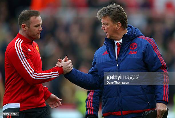 Louis van Gaal manager of Manchester United shakes hands with Wayne Rooney of Manchester United during the Barclays Premier League match between...
