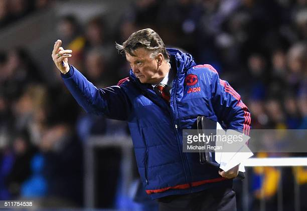 Louis van Gaal manager of Manchester United signals during the Emirates FA Cup fifth round match between Shrewsbury Town and Manchester United at...