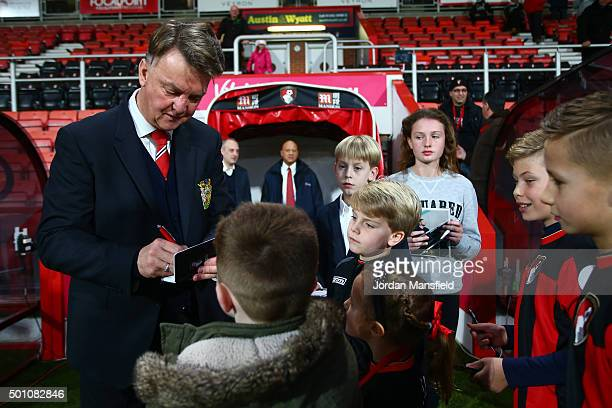 Louis van Gaal Manager of Manchester United signs autographs for young fans prior to the Barclays Premier League match between AFC Bournemouth and...