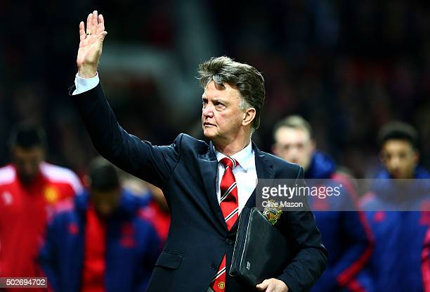 Louis van Gaal manager of Manchester United waves to the crowd as he walks out for the start of the Barclays Premier League match between Manchester...