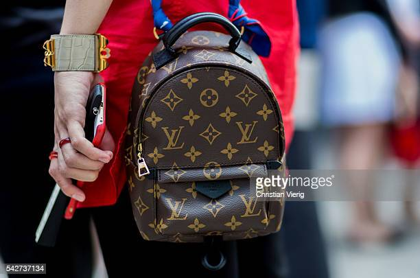 Louis Vuitton backpack outside Louis Vuitton during the Paris Fashion Week Menswear Spring/Summer 2017 on June 23 2016 in Paris France