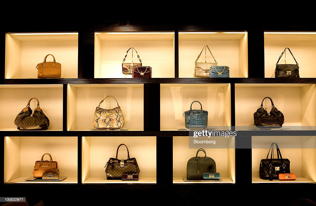 Louis Vuitton branded goods sit on display at the LVMH Moet Hennessy Louis Vuitton SA 'maison' store in New Bond Street in London, U.K., on Tuesday, May 25, 2010. The new London LV maison has been designed by the New York-based architect, Peter Marino, who also worked on the brand's Champs Elysees maison. Photographer: Chris Ratcliffe/Bloomberg via Getty Images