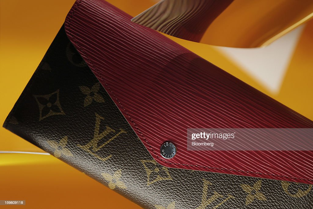 A Louis Vuitton branded purse is displayed in the store's window in the Ginza district of Tokyo, Japan, on Sunday, Jan. 20, 2013. Japan's consumer prices excluding fresh food, a benchmark monitored by the central bank, haven't advanced 2 percent for any year since 1997, when a national sales tax was increased. Photographer: Kiyoshi Ota/Bloomberg via Getty Images