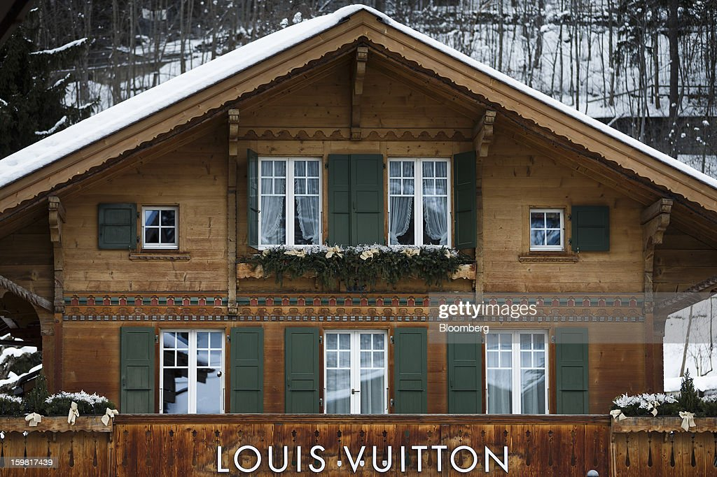 A Louis Vuitton logo sits above a store, and beneath the balcony of a Swiss chalet in Gstaad, Switzerland, on Saturday, Jan. 19, 2013. Options traders are pushing the cost of bearish wagers on Swiss shares to the lowest level in almost seven years amid optimism a decline in the franc versus the euro will benefit the nation's exporters. Photographer: Valentin Flauraud/Bloomberg via Getty Images