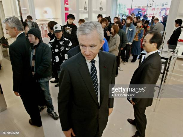 Louis Vuitton Moet Hennessy President Bernard Arnault looks around inside his shop during opening of the Christian Dior flagship boutique in Tokyo's...