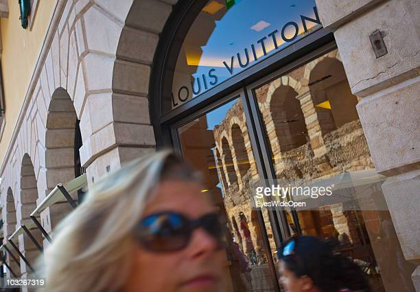 Louis Vuitton shop at Piazza Bra in front of the Arena di Verona on July 14 2010 in Verona Italy The famous Arena di Verona is popular for the annual...