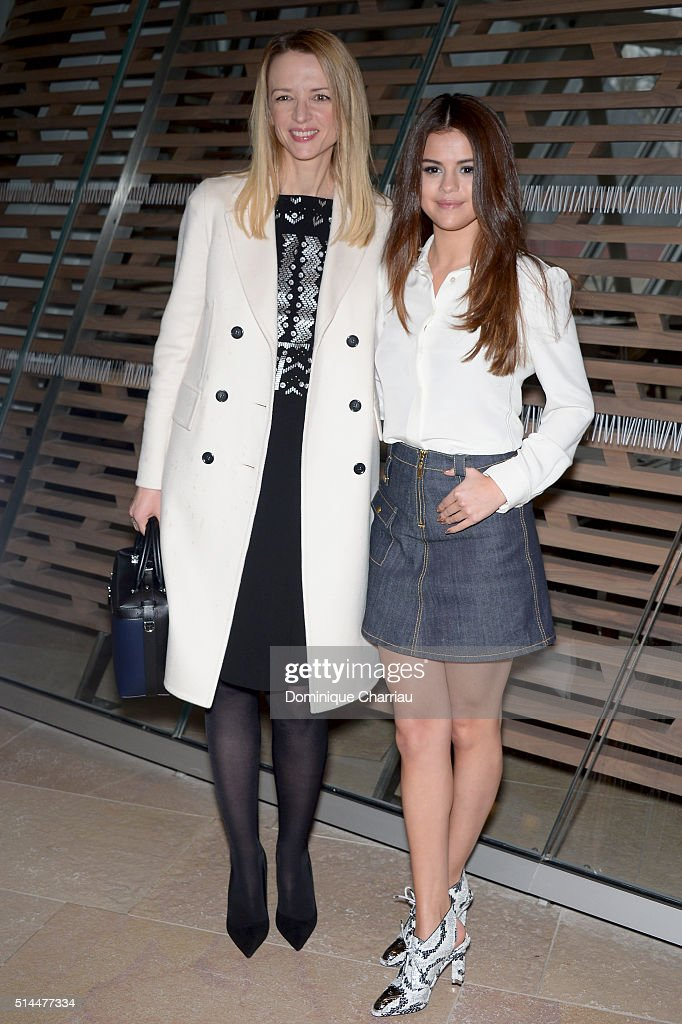 Louis Vuitton's executive vice president, Delphine Arnault and Actress Selena Gomez attend the Louis Vuitton show as part of the Paris Fashion Week Womenswear Fall/Winter 2016/2017 on March 9, 2016 in Paris, France.