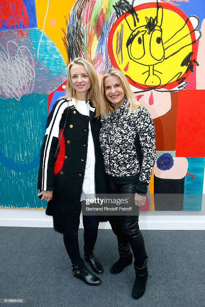 Louis Vuitton's executive vice president, Delphine Arnault and Eugenia Grandchamp Des Raux attend the FIAC 2016 - International Contemporary Art Fair : Press Preview. Held at Le Grand Palais on October 19, 2016 in Paris, France.