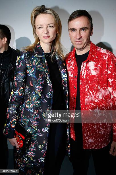 Louis Vuitton's executive vice president Delphine Arnault and Fashion Designer Raf Simons pose backstage after Christian Dior show as part of Paris...