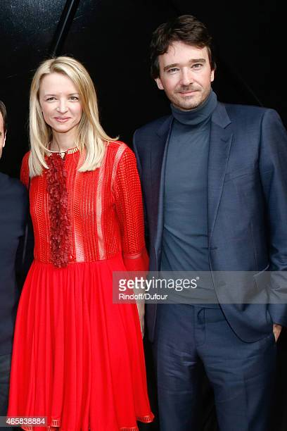 Louis Vuitton's executive vice president Delphine Arnault and her brother General manager of Berluti Antoine Arnault pose after the Louis Vuitton...