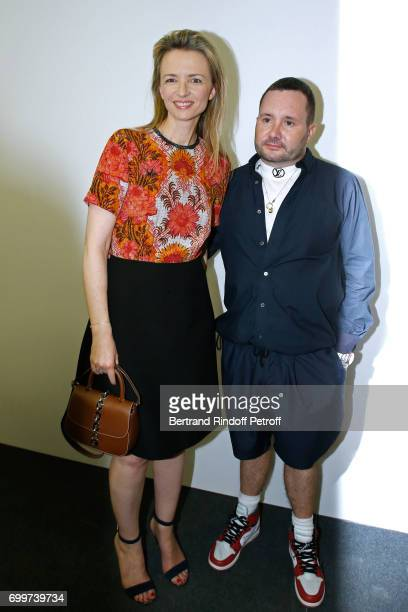 Louis Vuitton's executive vice president Delphine Arnault and Stylist Kim Jones pose after the Louis Vuitton Menswear Spring/Summer 2018 show as part...