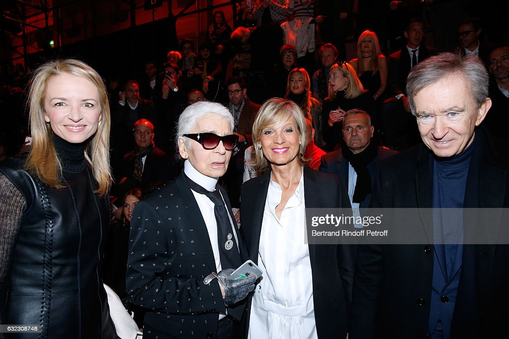 Louis Vuitton's executive vice president, Delphine Arnault, Stylist Karl Lagerfeld, Owner of LVMH Luxury Group Bernard Arnault and his wife Helene Arnault attend the Dior Homme Menswear Fall/Winter 2017-2018 show as part of Paris Fashion Week on January 21, 2017 in Paris, France.