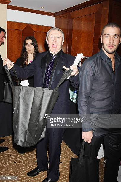 LONDON FEBRUARY 20 Louis Walsh and Shane Ward pose at the Brit Awards 2008 Sony BMG After Party Gift Lounge at Galvin at Windows at the London Hilton...