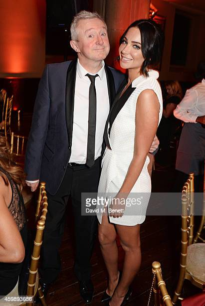 Louis Walsh and Tulisa Contostavlos attend the Cosmopolitan Ultimate Women of the Year Awards at One Mayfair on December 3 2014 in London England
