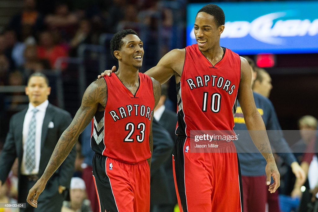 Louis Williams celebrates with DeMar DeRozan of the Toronto Raptors during the second half at Quicken Loans Arena on November 22 2014 in Cleveland...