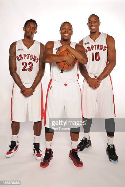 Louis Williams Kyle Lowry and DeMar DeRozan of the Toronto Raptors pose for a photo during Media Day at the Air Canada Centre in Toronto Ontario...