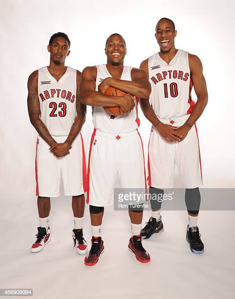 Louis Williams Kyle Lowry and DeMar DeRozan of the Toronto Raptors pose for a photo during Media Day September 29 2014 at the Air Canada Centre in...