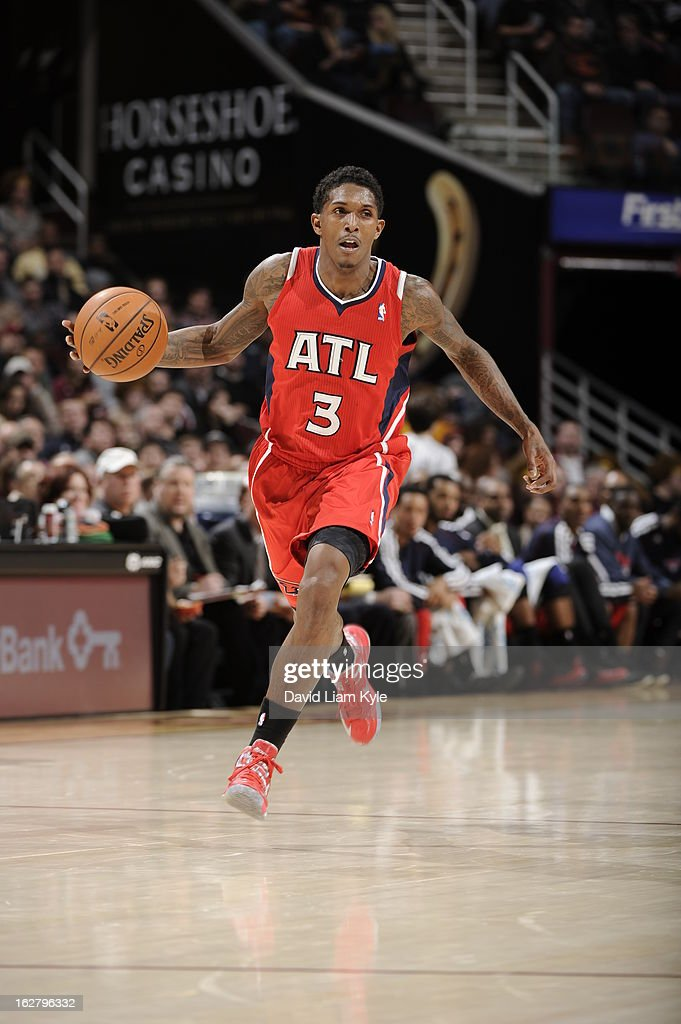 <a gi-track='captionPersonalityLinkClicked' href=/galleries/search?phrase=Louis+Williams&family=editorial&specificpeople=670315 ng-click='$event.stopPropagation()'>Louis Williams</a> #3 of the Atlanta Hawks brings the ball up court during the game against the Cleveland Cavaliers at The Quicken Loans Arena on December 28, 2012 in Cleveland, Ohio.