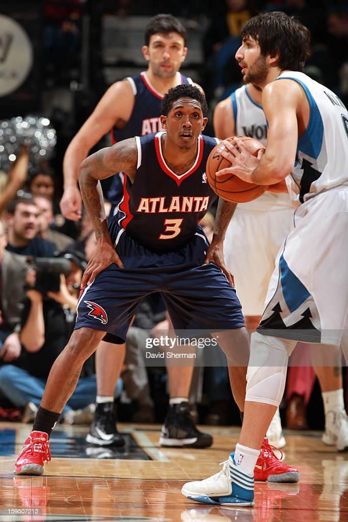 <a gi-track='captionPersonalityLinkClicked' href=/galleries/search?phrase=Louis+Williams&family=editorial&specificpeople=670315 ng-click='$event.stopPropagation()'>Louis Williams</a> #3 of the Atlanta Hawks defends <a gi-track='captionPersonalityLinkClicked' href=/galleries/search?phrase=Ricky+Rubio&family=editorial&specificpeople=4028920 ng-click='$event.stopPropagation()'>Ricky Rubio</a> #9 of the Minnesota Timberwolves on January 8, 2013 at Target Center in Minneapolis, Minnesota.