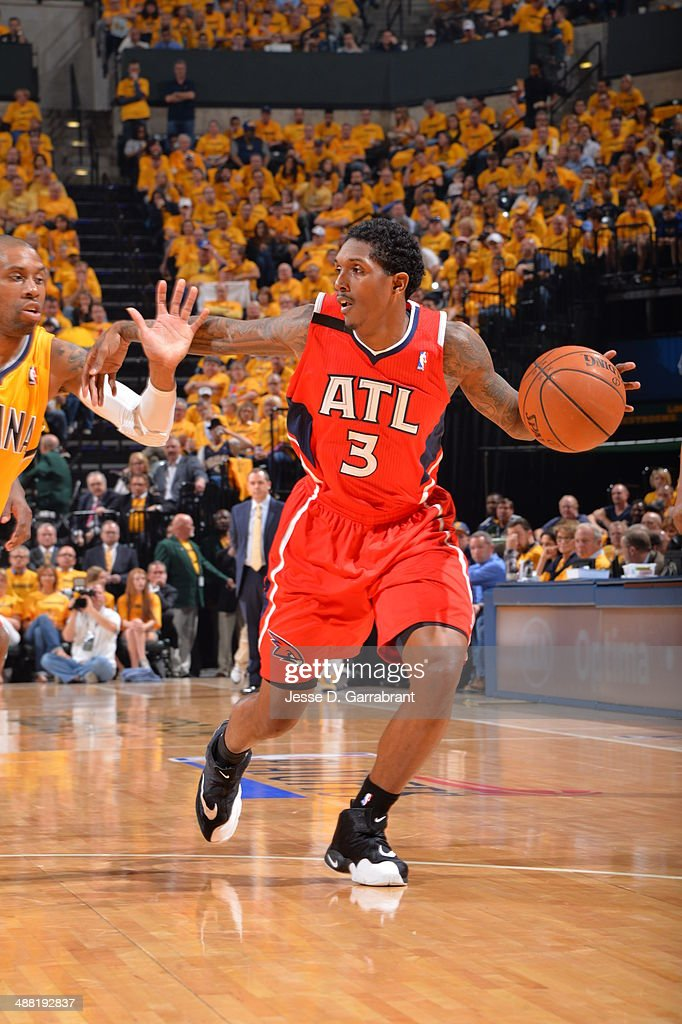 Louis Williams #3 of the Atlanta Hawks dribbles the ball against Roy Hibbert #55 of the Indiana Pacers during Game Seven of the Eastern Conference Quarterfinals during the 2014 NBA Playoffs on May 3, 2014 at Bankers Life Fieldhouse in Indianapolis, Indiana.
