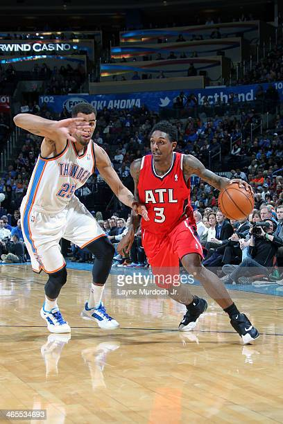 Louis Williams of the Atlanta Hawks dribbles the ball against the Oklahoma City Thunder during an NBA game on January 27 2014 at the Chesapeake...