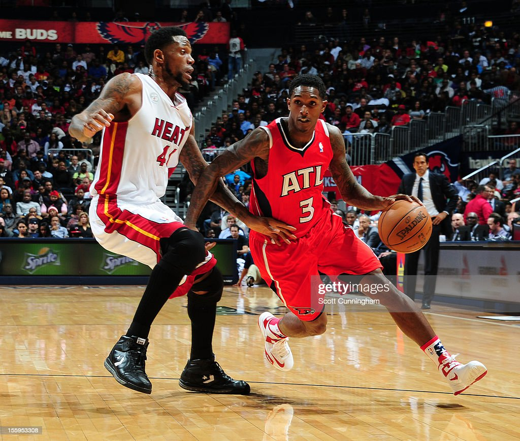<a gi-track='captionPersonalityLinkClicked' href=/galleries/search?phrase=Louis+Williams&family=editorial&specificpeople=670315 ng-click='$event.stopPropagation()'>Louis Williams</a> #3 of the Atlanta Hawks dribbles the ball against <a gi-track='captionPersonalityLinkClicked' href=/galleries/search?phrase=Udonis+Haslem&family=editorial&specificpeople=201748 ng-click='$event.stopPropagation()'>Udonis Haslem</a> #40 of the Miami Heat at Philips Arena on November 9, 2012 in Atlanta, Georgia.