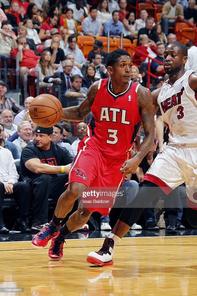 Louis Williams #3 of the Atlanta Hawks drives against Dwyane Wade #3 of the Miami Heat on December 10, 2012 at American Airlines Arena in Miami, Florida.