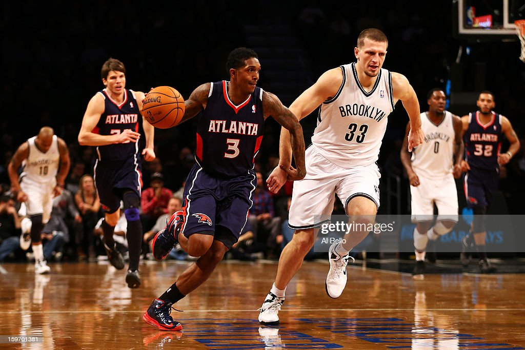 Louis Williams #3 of the Atlanta Hawks drives against Mirza Teletovic #33 of the Brooklyn Nets in the second quarter of the game at Barclays Center on January 18, 2013 in the Brooklyn borough of New York City.