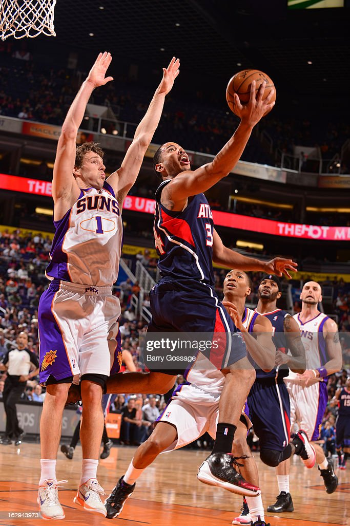 Louis Williams #3 of the Atlanta Hawks drives for a layup against Goran Dragic #1 of the Phoenix Suns on March 1, 2013 at U.S. Airways Center in Phoenix, Arizona.