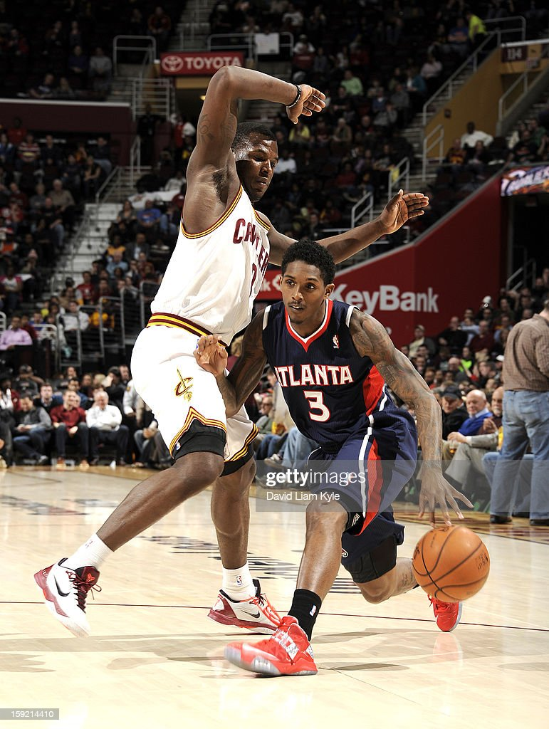 Louis Williams #3 of the Atlanta Hawks drives to the basket against Dion Waiters #3 of the Cleveland Cavaliers at The Quicken Loans Arena on January 9, 2013 in Cleveland, Ohio.
