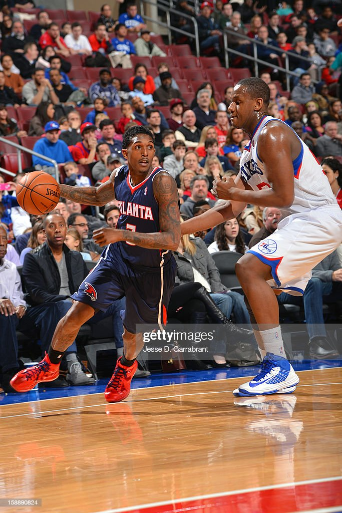 <a gi-track='captionPersonalityLinkClicked' href=/galleries/search?phrase=Louis+Williams&family=editorial&specificpeople=670315 ng-click='$event.stopPropagation()'>Louis Williams</a> #3 of the Atlanta Hawks drives to the basket against <a gi-track='captionPersonalityLinkClicked' href=/galleries/search?phrase=Lavoy+Allen&family=editorial&specificpeople=4628334 ng-click='$event.stopPropagation()'>Lavoy Allen</a> #50 of the Philadelphia 76ers during the game at the Wells Fargo Center on December 21, 2012 in Philadelphia, Pennsylvania.