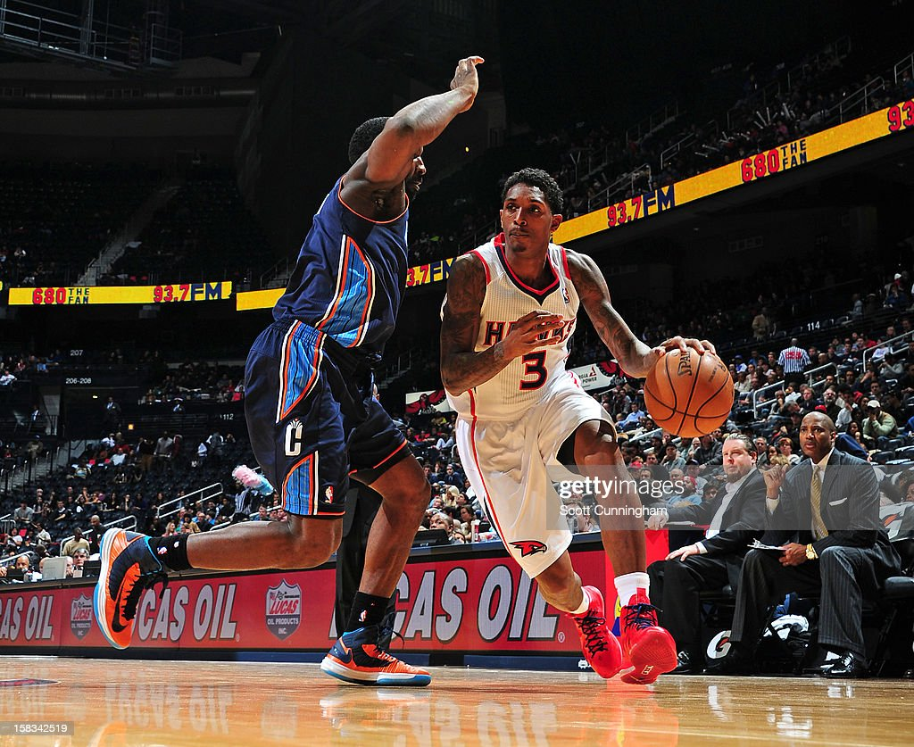 Louis Williams #3 of the Atlanta Hawks drives to the basket against the Charlotte Bobcats at Philips Arena on December 13 ,2012 in Atlanta, Georgia.