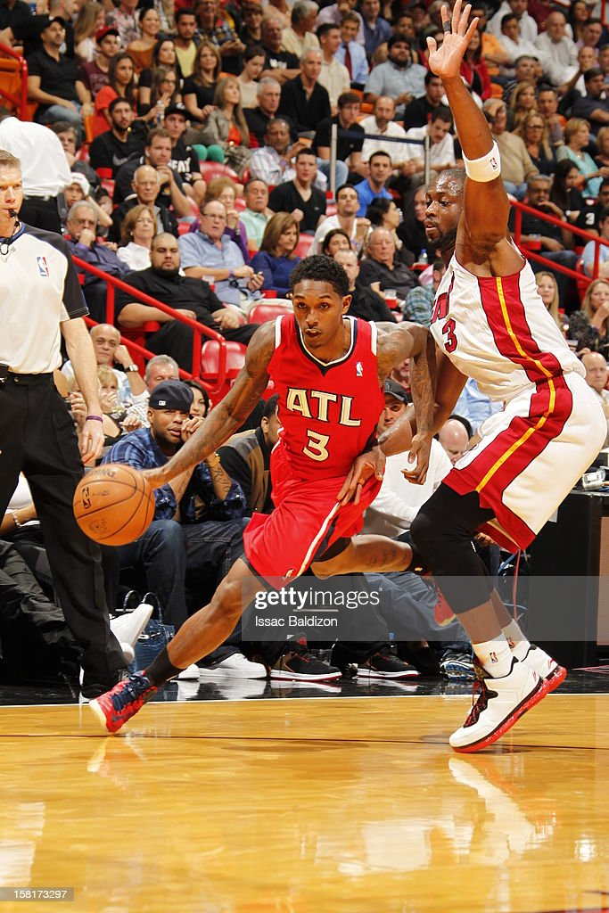 Louis Williams #3 of the Atlanta Hawks drives under pressure during a game between the Atlanta Hawks and the Miami Heat on December 10, 2012 at American Airlines Arena in Miami, Florida.
