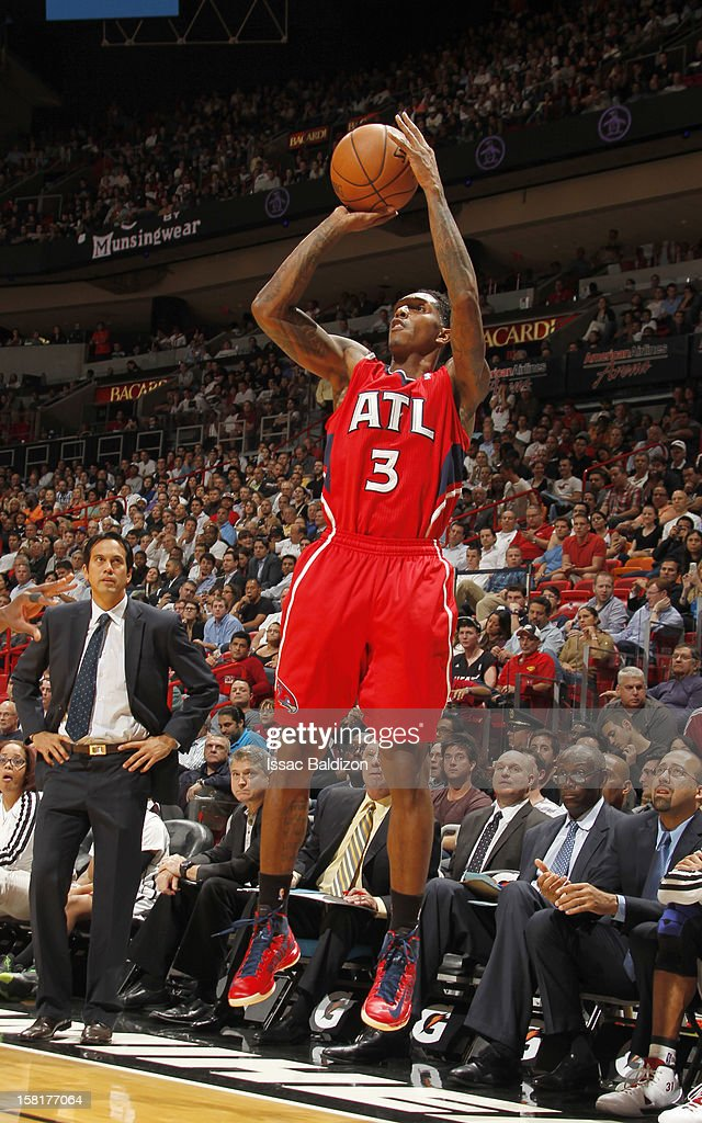 Louis Williams #3 of the Atlanta Hawks goes for a jump shot during a game between the Atlanta Hawks and the Miami Heat on December 10, 2012 at American Airlines Arena in Miami, Florida.