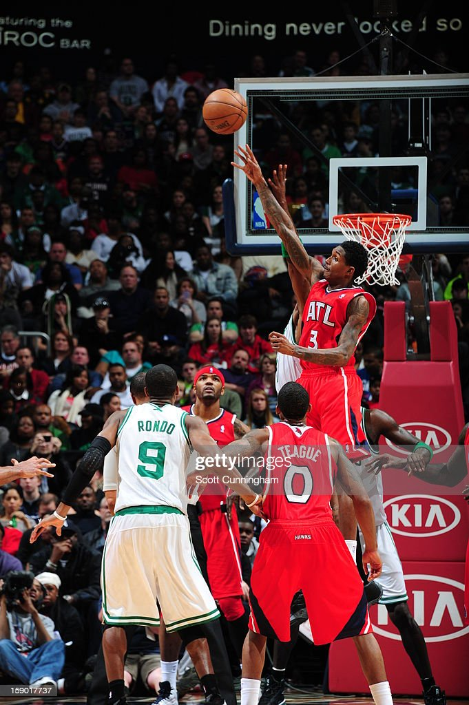 Louis Williams #3 of the Atlanta Hawks goes up for a rebound against the Boston Celtics on January 5, 2013 at Philips Arena in Atlanta, Georgia.