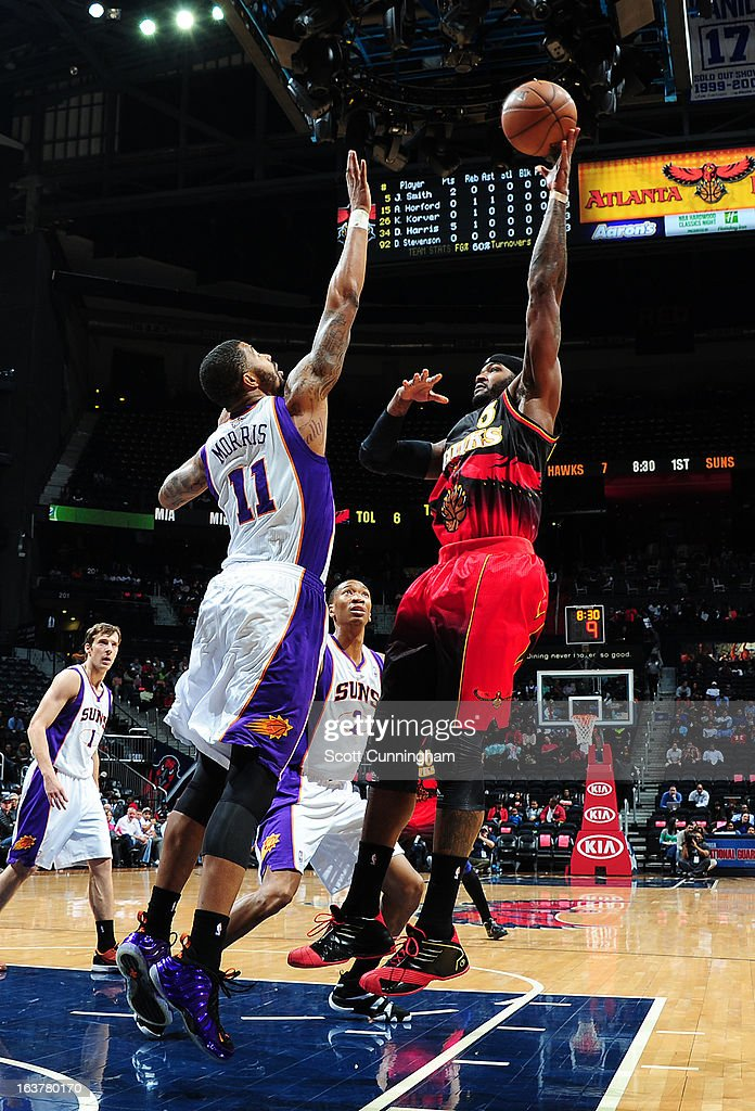 <a gi-track='captionPersonalityLinkClicked' href=/galleries/search?phrase=Louis+Williams&family=editorial&specificpeople=670315 ng-click='$event.stopPropagation()'>Louis Williams</a> #3 of the Atlanta Hawks goes up for the baby hook against <a gi-track='captionPersonalityLinkClicked' href=/galleries/search?phrase=Markieff+Morris&family=editorial&specificpeople=5293881 ng-click='$event.stopPropagation()'>Markieff Morris</a> #11 of the Phoenix Suns on March 15, 2013 at Philips Arena in Atlanta, Georgia.