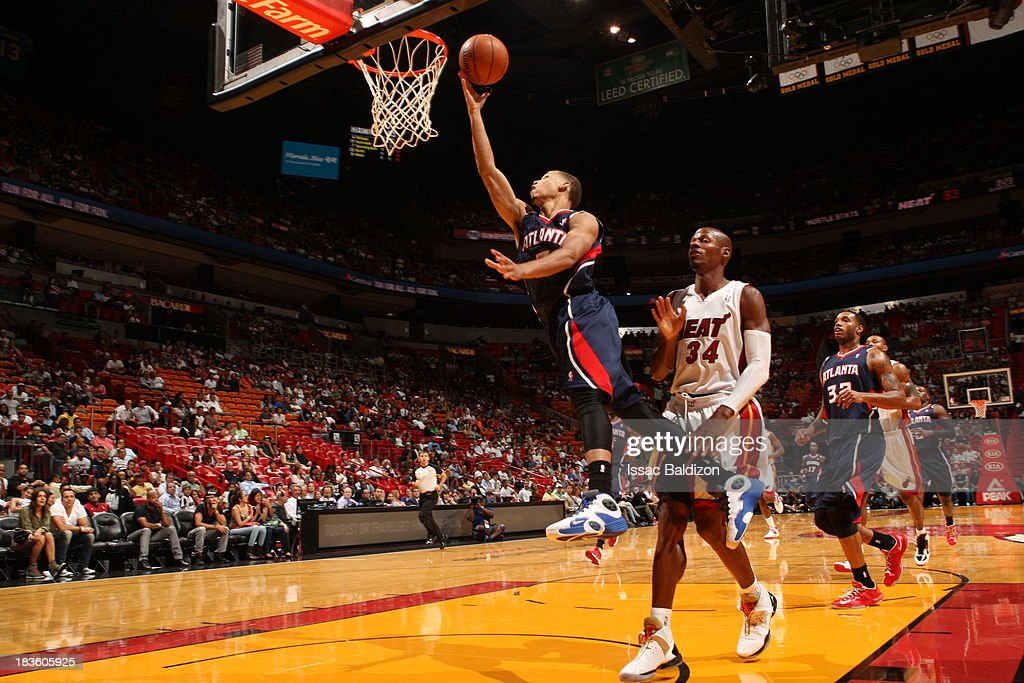<a gi-track='captionPersonalityLinkClicked' href=/galleries/search?phrase=Louis+Williams&family=editorial&specificpeople=670315 ng-click='$event.stopPropagation()'>Louis Williams</a> #3 of the Atlanta Hawks goes up for the layup against the Miami Heat during a game on October 7, 2013 at American Airlines Arena in Miami, Florida.