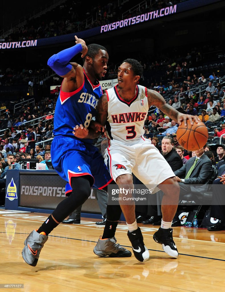 Louis Williams #3 of the Atlanta Hawks handles the ball against the Philadelphia 76ers on March 31, 2014 at Philips Arena in Atlanta, Georgia.