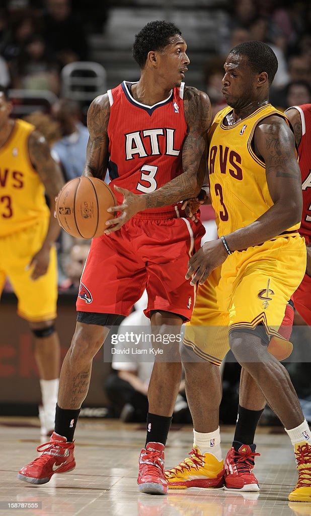 Louis Williams #3 of the Atlanta Hawks looks for an open teammate defended closely by Dion Waiters #3 of the Cleveland Cavaliers at The Quicken Loans Arena on December 28, 2012 in Cleveland, Ohio.
