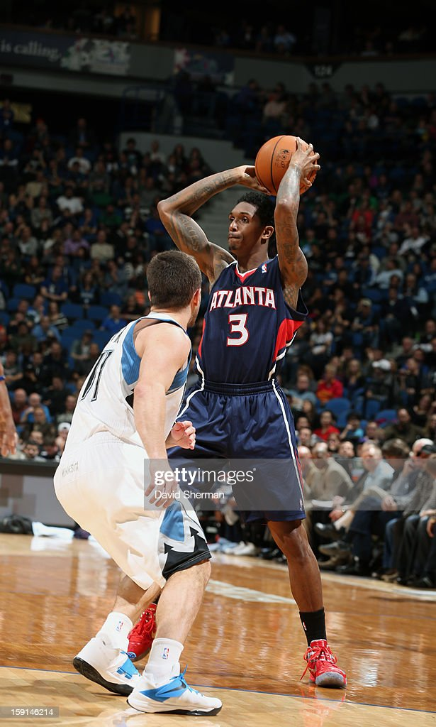 Louis Williams #3 of the Atlanta Hawks looks to pass the ball against J.J. Barea #11 of the Minnesota Timberwolves during the game on January 8, 2013 at Target Center in Minneapolis, Minnesota.