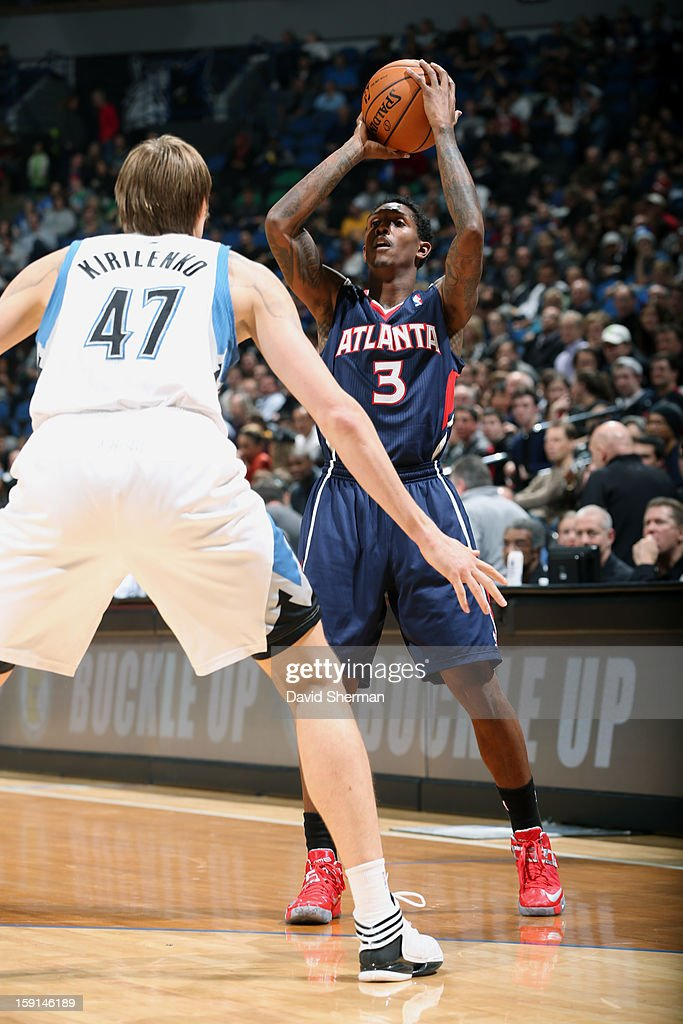 Louis Williams #3 of the Atlanta Hawks looks to pass the ball against Andrei Kirilenko #47 of the Minnesota Timberwolves during the game on January 8, 2013 at Target Center in Minneapolis, Minnesota.