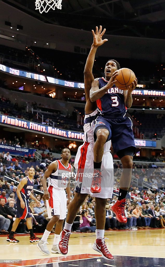<a gi-track='captionPersonalityLinkClicked' href=/galleries/search?phrase=Louis+Williams&family=editorial&specificpeople=670315 ng-click='$event.stopPropagation()'>Louis Williams</a> #3 of the Atlanta Hawks puts up a shot against the Washington Wizards at Verizon Center on December 18, 2012 in Washington, DC.