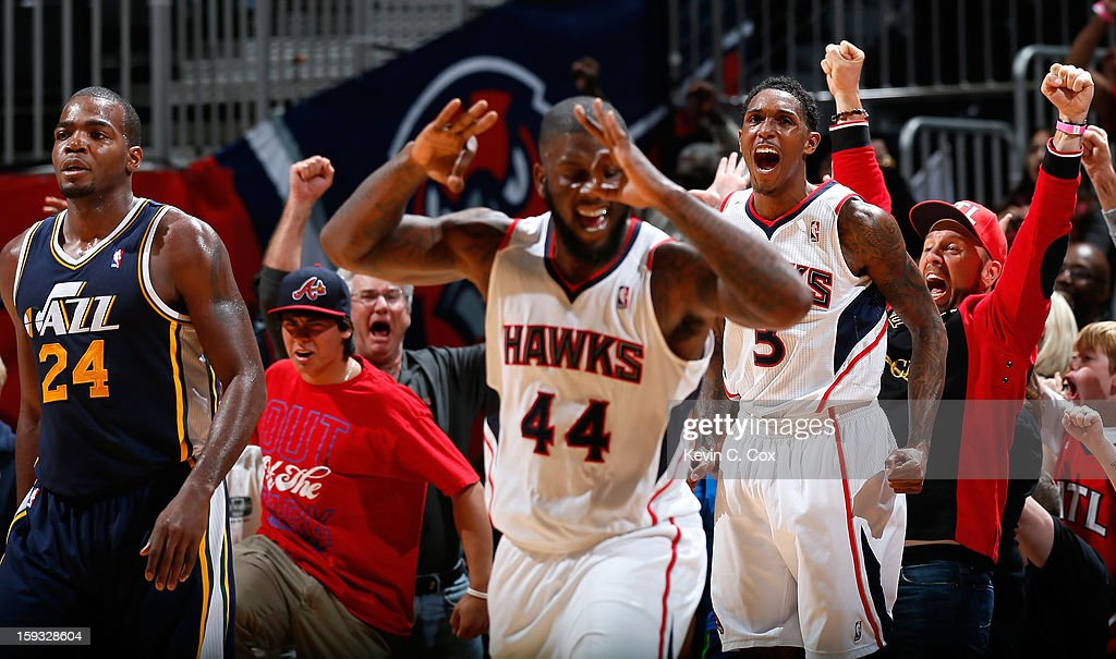 <a gi-track='captionPersonalityLinkClicked' href=/galleries/search?phrase=Louis+Williams&family=editorial&specificpeople=670315 ng-click='$event.stopPropagation()'>Louis Williams</a> #3 of the Atlanta Hawks reacts after hitting a three-point basket in the final seconds against <a gi-track='captionPersonalityLinkClicked' href=/galleries/search?phrase=Paul+Millsap&family=editorial&specificpeople=880017 ng-click='$event.stopPropagation()'>Paul Millsap</a> #24 of the Utah Jazz at Philips Arena on January 11, 2013 in Atlanta, Georgia.