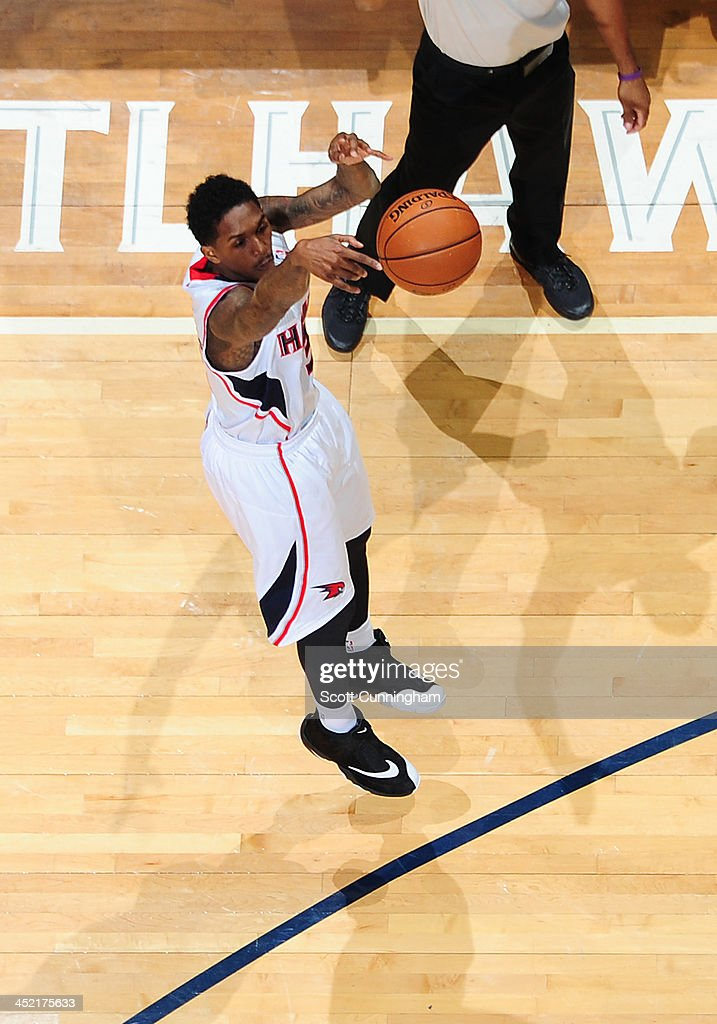 Louis Williams #3 of the Atlanta Hawks shoots a three point shot against the Orlando Magic on November 26, 2013 at Philips Arena in Atlanta, Georgia.